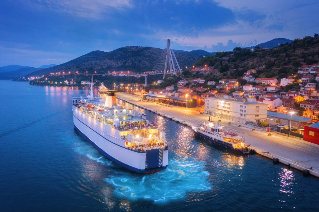 Aerial view of cruise ship at harbor at night
