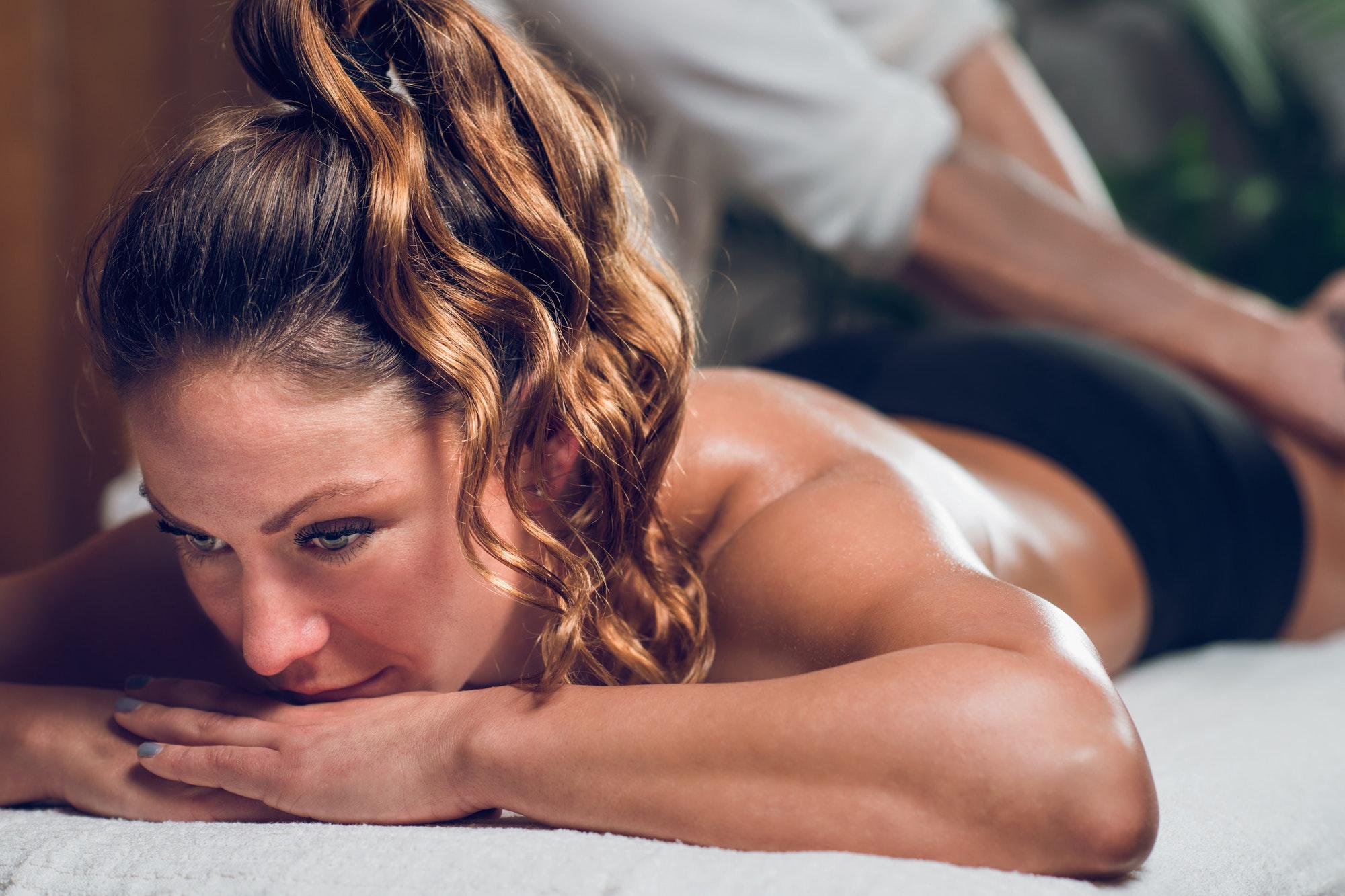 Beautiful young woman enjoying anti cellulite massage